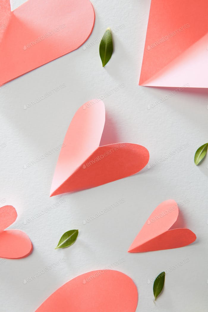 Greeting patter with valentines hearts in a color of the year 2019 Living Coral pantone on a white