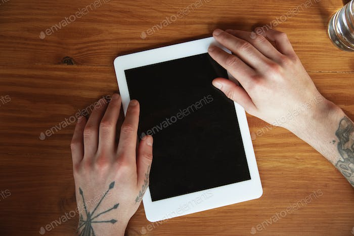 Close up of male hands using tablet with blank screen, copyspace, education and business concept