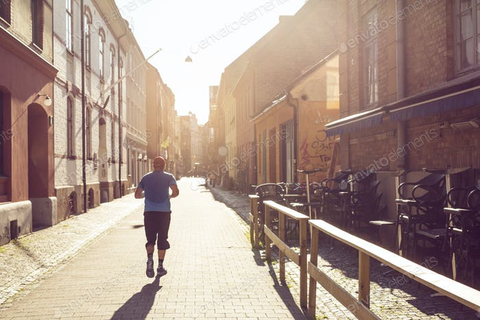 Man running in old town
