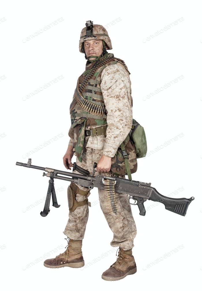 Soldier with machine gun isolated studio shoot