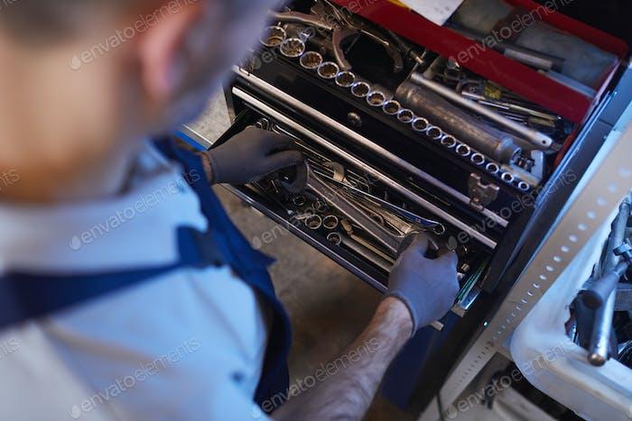 Mechanic Choosing Tools Above View