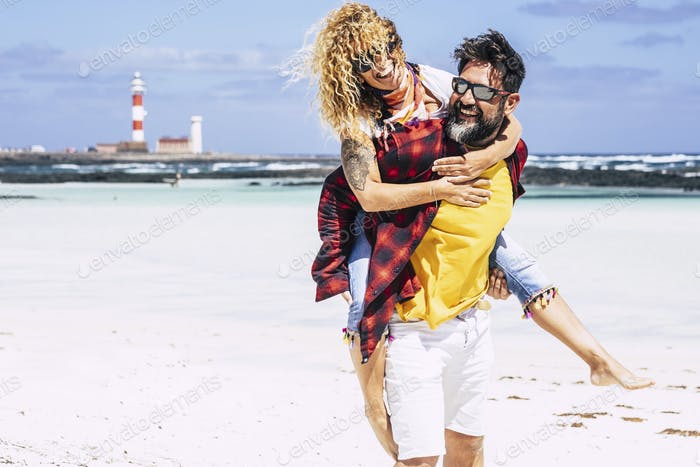 Happy caucasian adult young couple people play and enjoy together the summer holiday