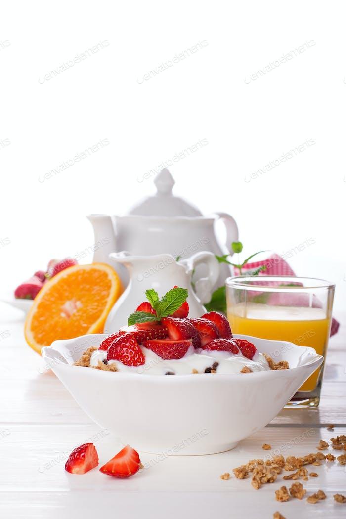 Yogurt with homemade granola and strawberries