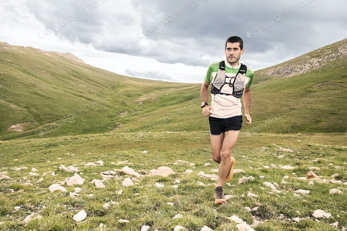 Athlete Runner Runs In Mountain