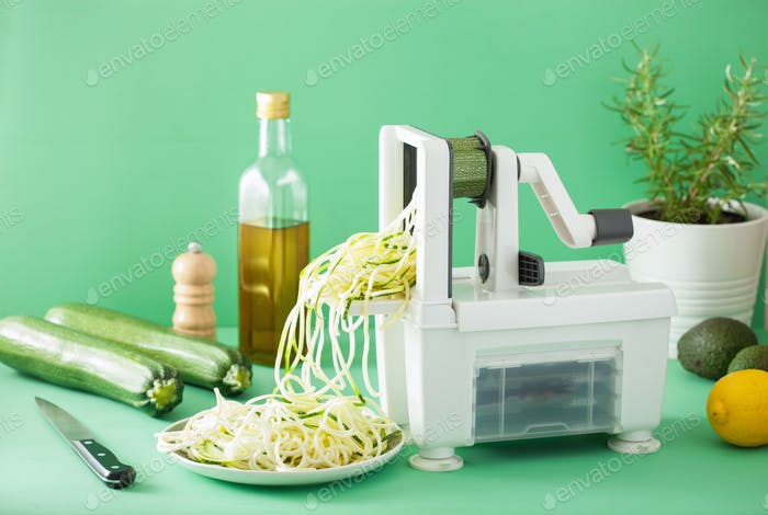 spiralizing courgette raw vegetable with spiralizer
