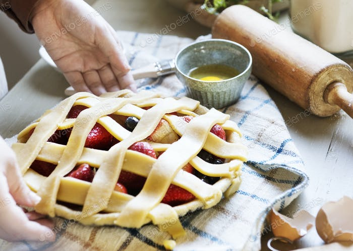 A person baking fruit pie food photography recipe idea