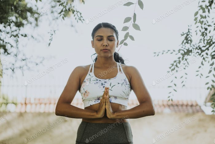 Woman practicing yoga for relaxation
