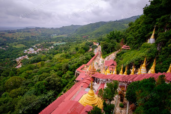 View of buddhist gold pagodas and colorful staircase to Pindaya