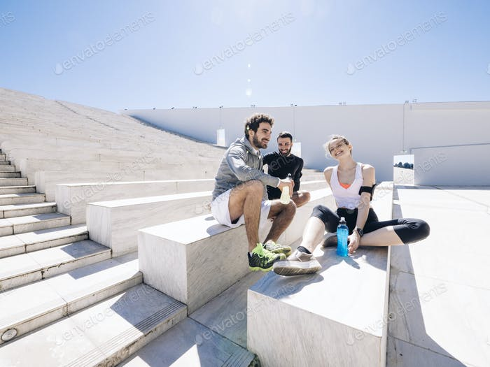 athletic team relaxing after jogging