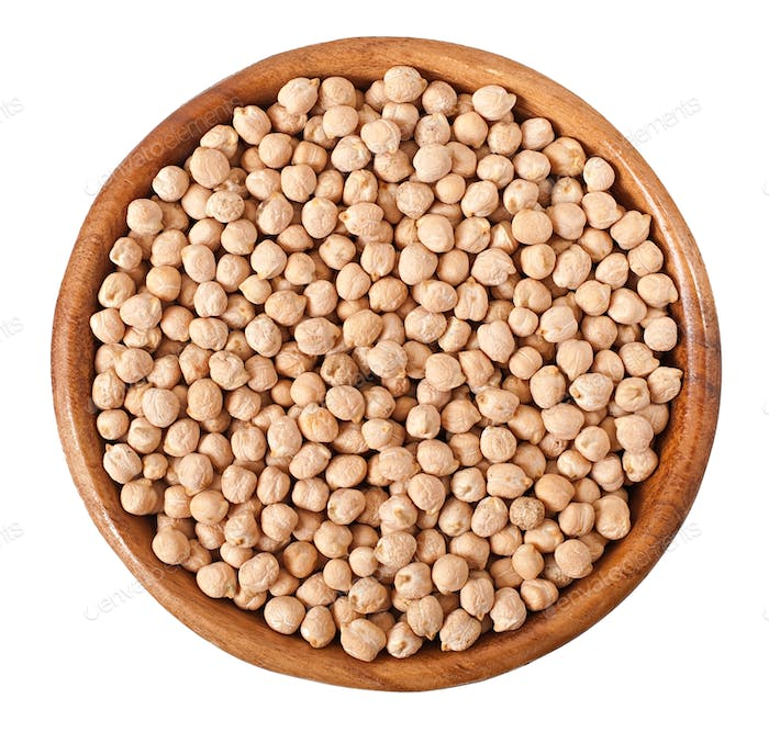 Uncooked chickpeas in wooden bowl on white background