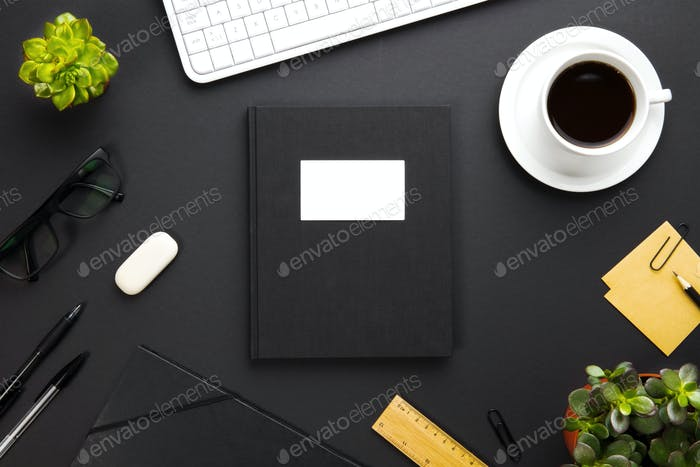 Folder With Label Surrounded By Office Supplies On Gray Desk