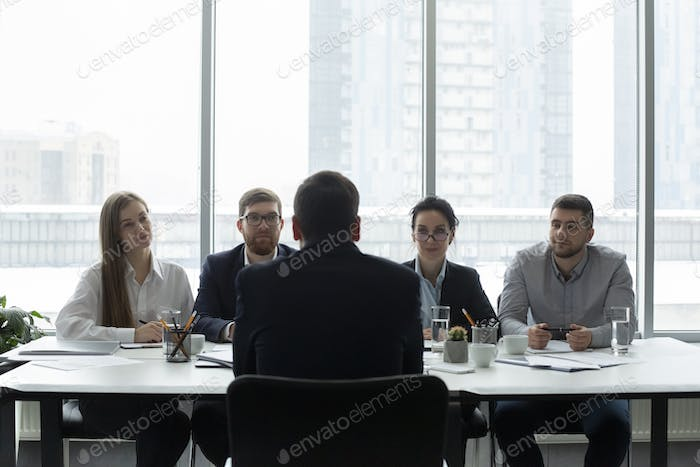 Hr managers interviewing job applicant and listening man