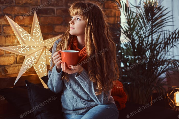 Redhead girl in a decorated living room at Christmas time