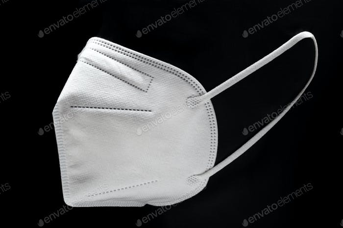 KN95 Face mask isolated on black background