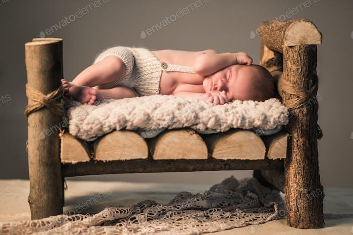 Little newborn sleeping baby lies on the skin