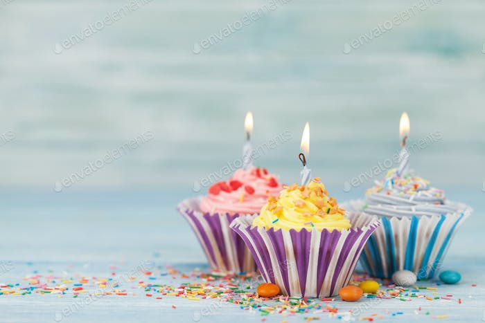 Sweet cupcakes with candles