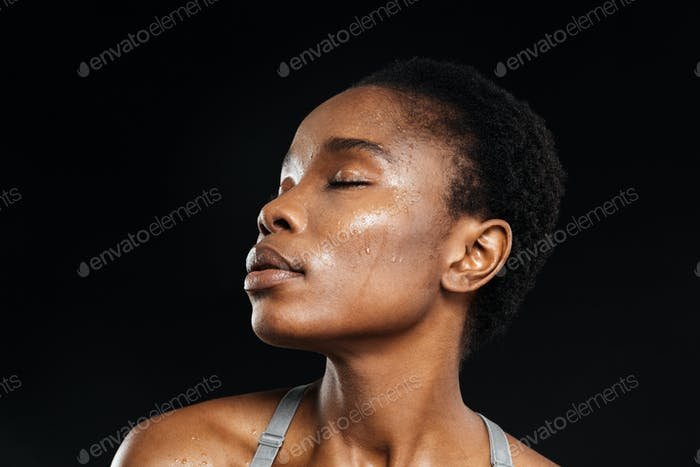 Close-up portrait of african woman with eyes closed