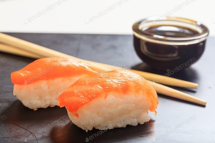 Nigiri salmon on black background