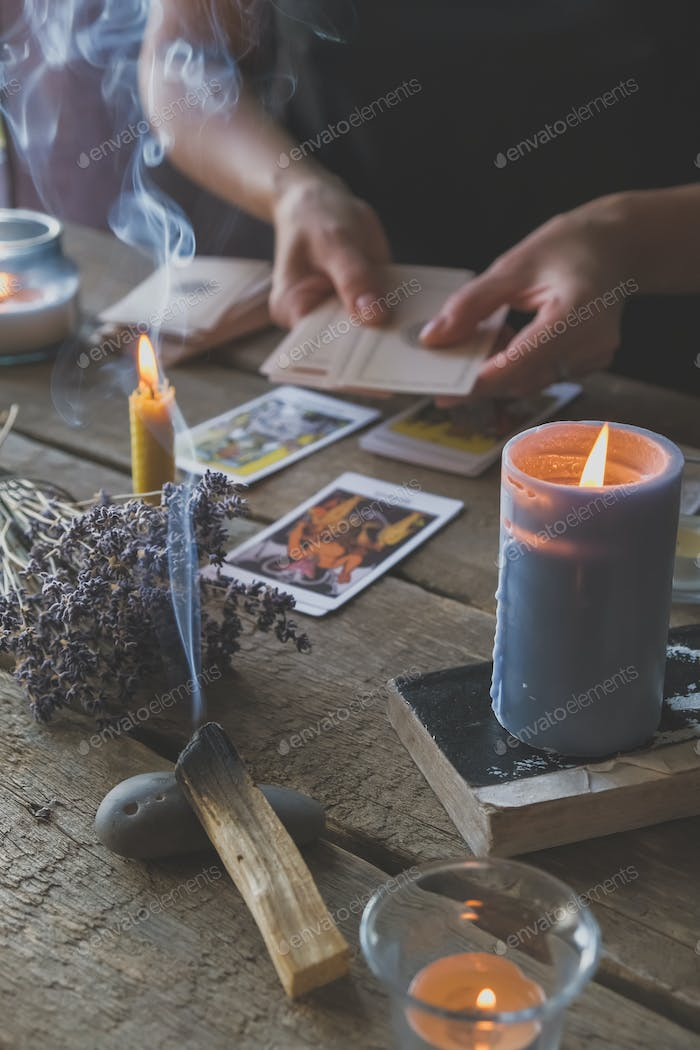 Tarot cards, Fortune telling on tarot cards at night by candlelight, magic crystal, occultism