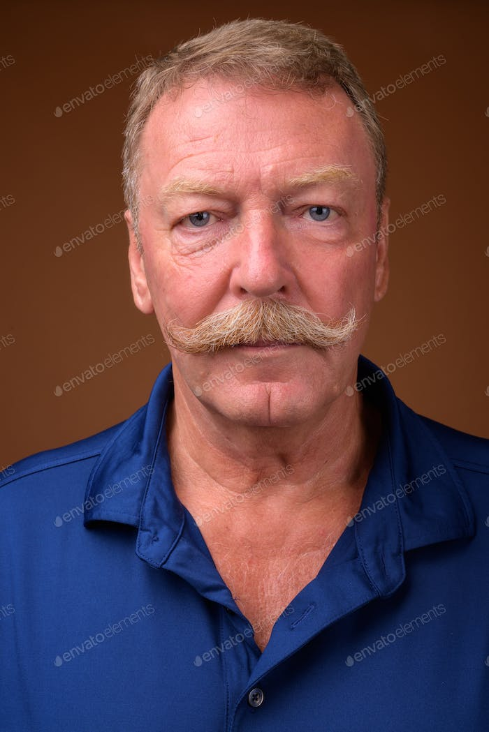Face of handsome senior man with mustache
