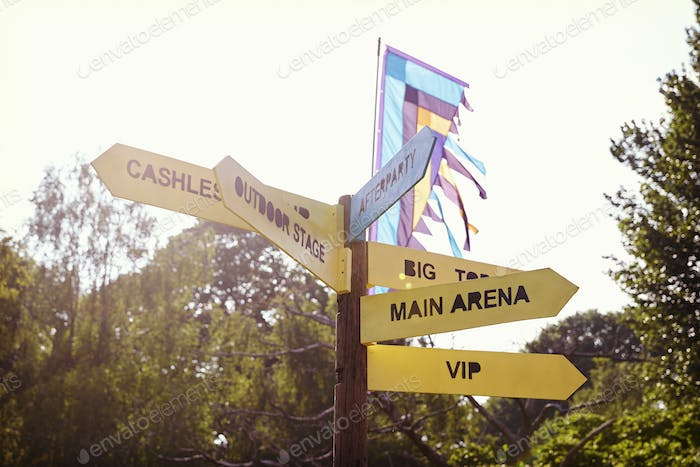 Close Up Of Signpost At Outdoor Music Festival