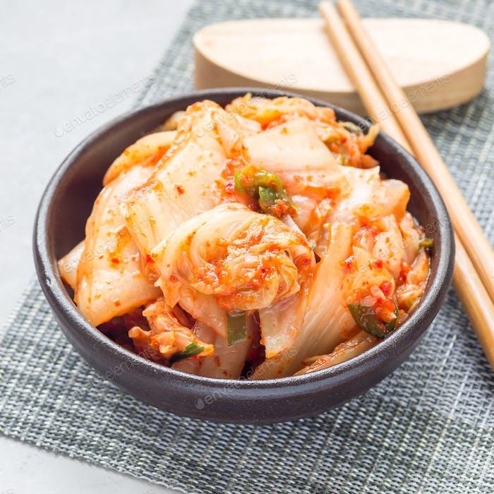 Kimchi cabbage. Korean appetizer in a ceramic bowl, square format