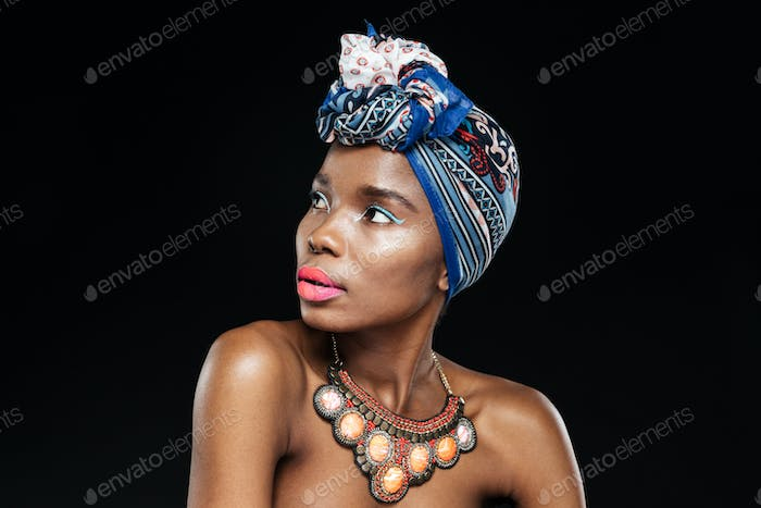 Close-up portrait of a beautiful african woman looking away