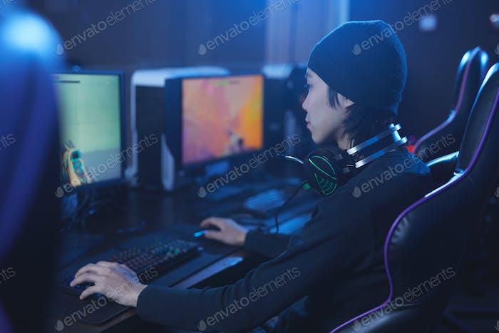 Asian Man Playing Computer Game