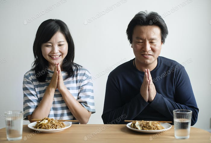 Asian couple about to eat noodles