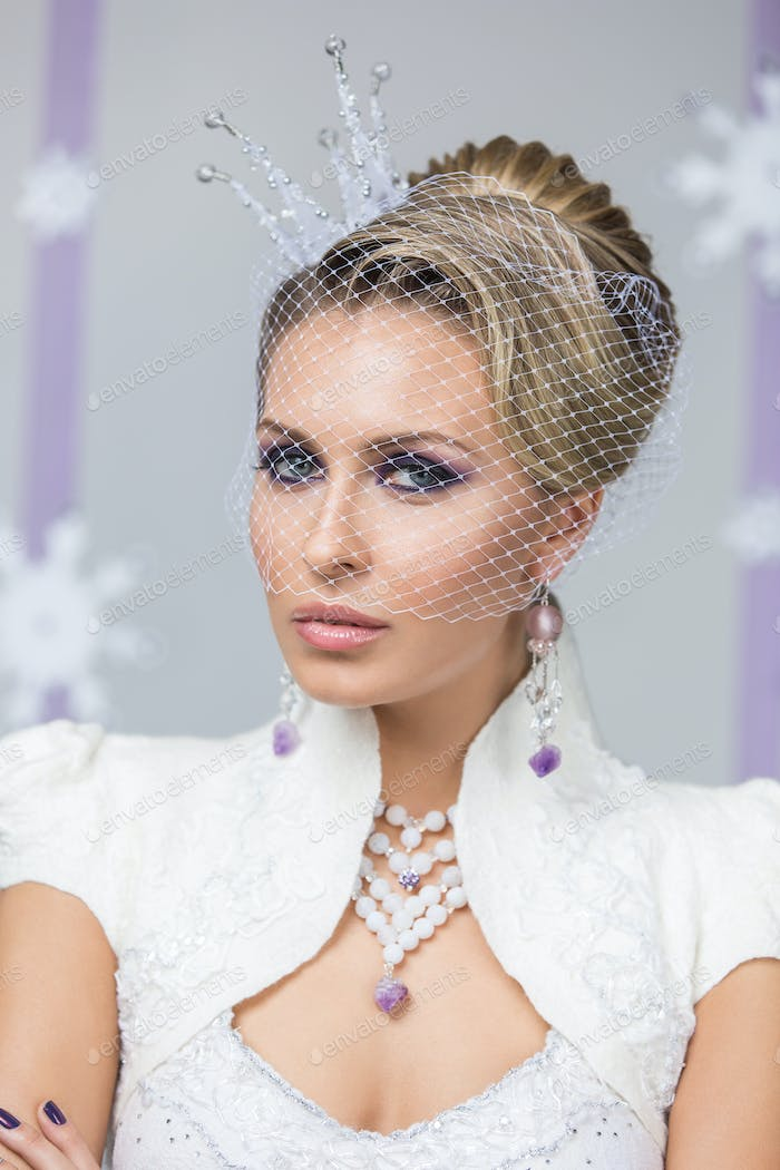 Beautiful winter bride with crown