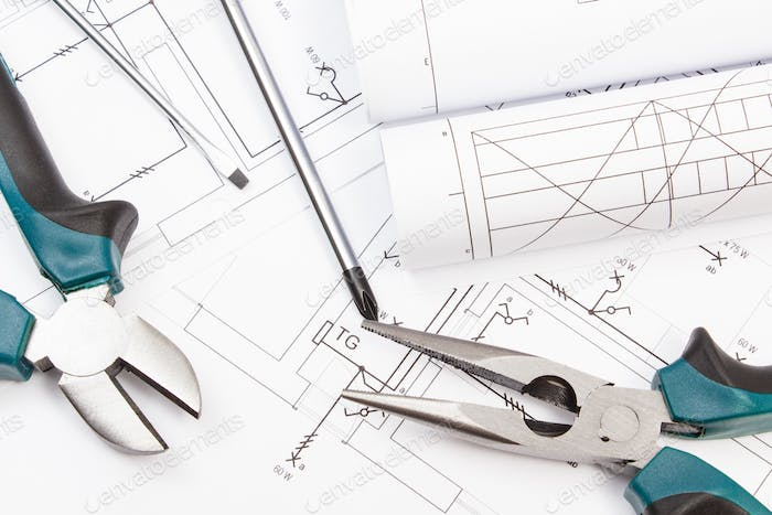 Pliers, screwdriver and diagrams of plan with electrical installation. Building home