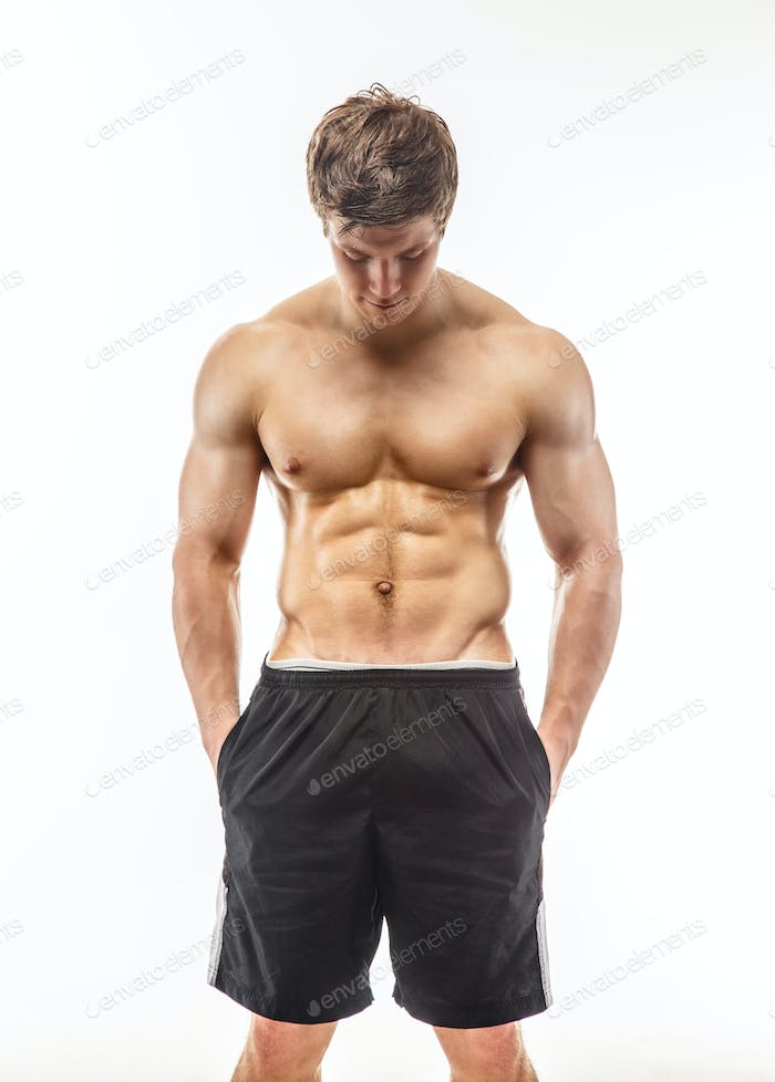 Young muscular guy in black shorts.