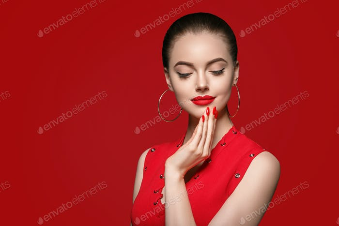 Beautiful curle hair female in red with red lips and dress manicure, beauty rose afro hairstyle
