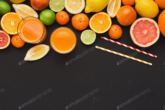 Variety of ripe citruses on black background