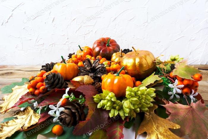 Thanksgiving greeting background with pumpkins and leaves table