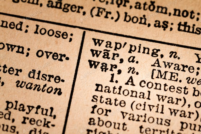 Close-up of an Opened Dictionary showing the Word WAR