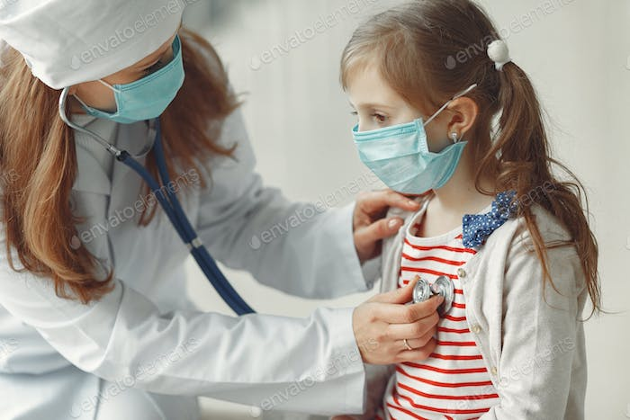 A doctor woman is examinating a child with stethoscope