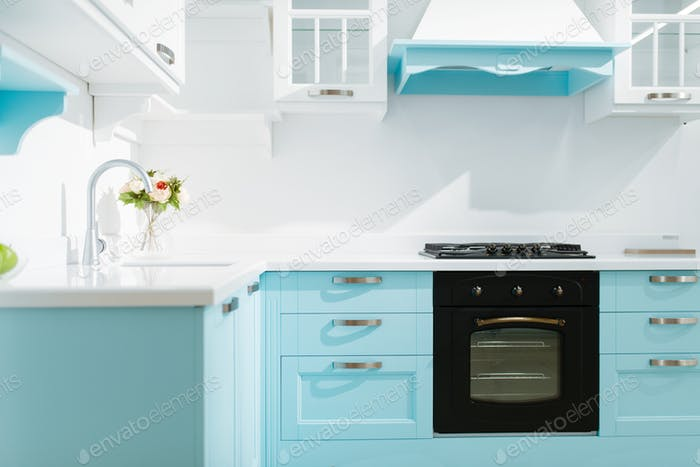 Luxury kitchen interior in white and blue tones