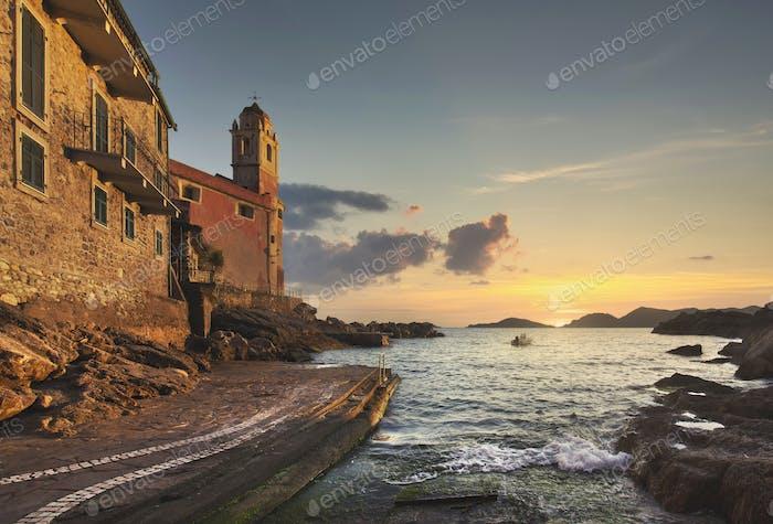 Tellaro sea village, church and boat at sunset. Cinque terre, Ligury Italy