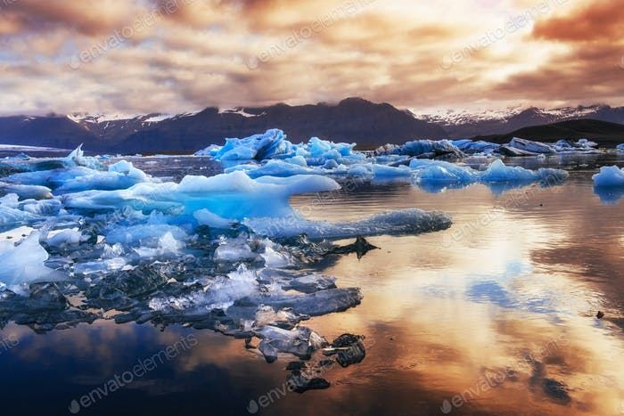 Icebergs floating in Jokulsarlon glacial lake in the west. South