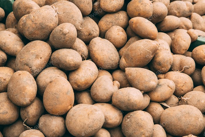 Organic Brown Potatoes On Agricultural Market.