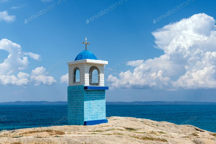 Traditional Greek small church or chapel on sea backround