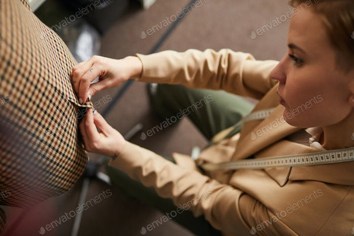 Tailor making a dress