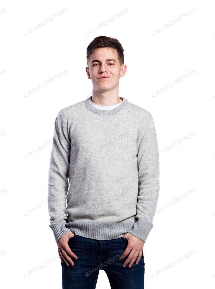 Teenage boy in jeans and sweater. Studio shot, isolated.