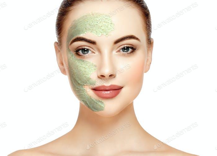 Woman clay face mask peeling beauty portrait. Studio shot.