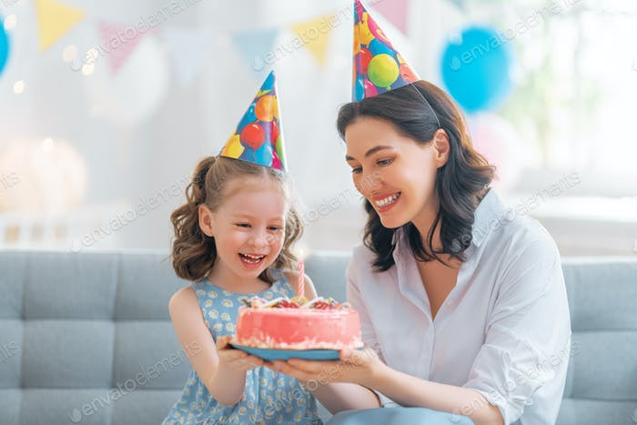 Mother and daughter are celebrating birthday.