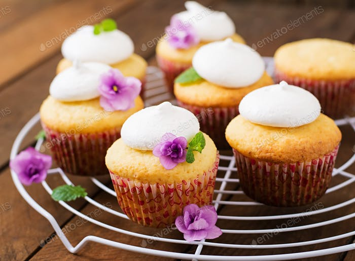 Cottage cheese cupcakes with meringue decorated flower and mint leaves