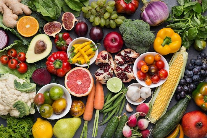Verschiedene frische reife Früchte und Gemüse Hintergrund