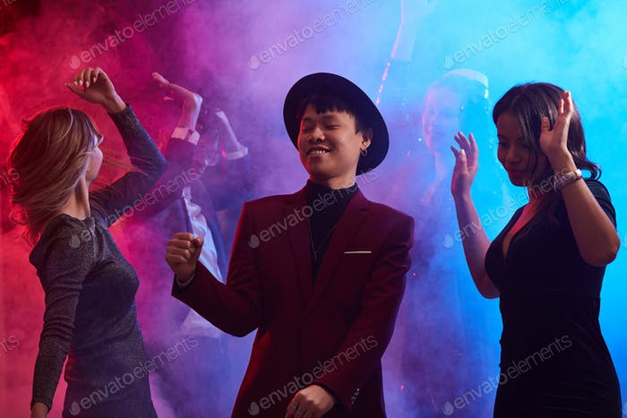 People Dancing in Smoky Nightclub