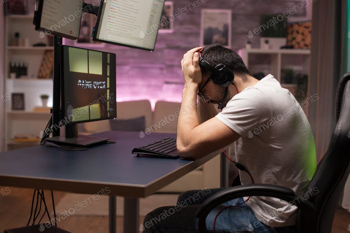 Side view of game over for man with headphones